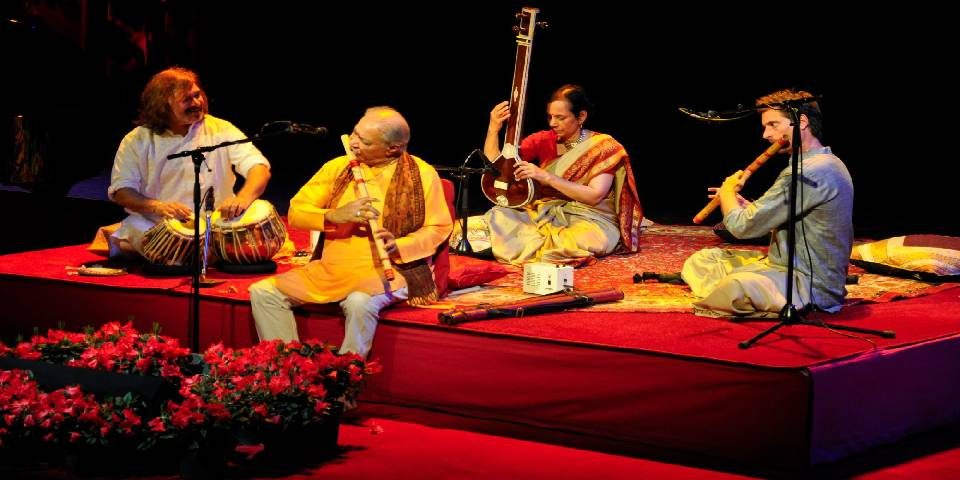 Image That Resembles Four Musical Artists Performing in Musical Concert.