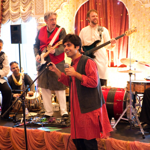 Live performance in a indian wedding with two lead guitarists on stage decorated by Wedding Event Planner Kiyoh