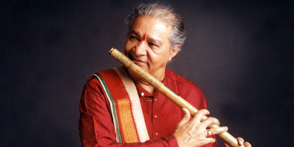 Great Indian Legend Playing Wooden Flute In A Black Background.