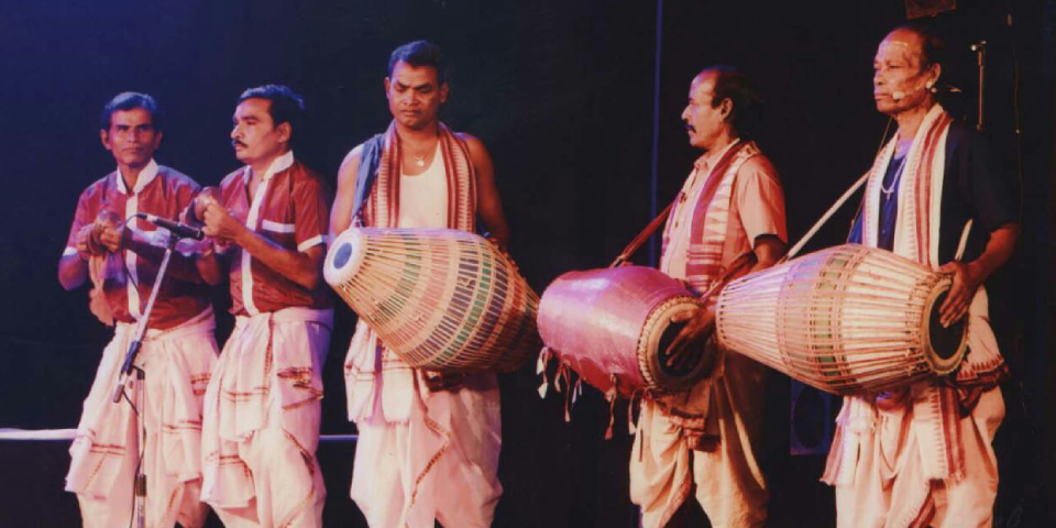 Group Of Folk Singers Playing Folk Ballad In A Stage Performance.
