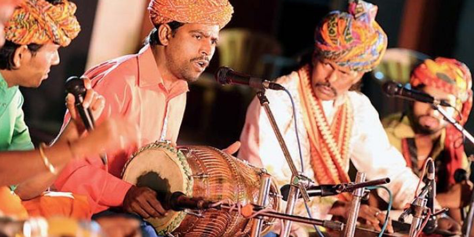 Indian Folk Singers Singing Folk Songs While Playing Their Instruments.