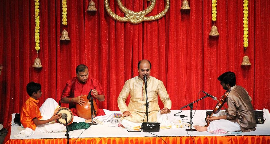 An Image Representing South Indian Musicians Performing With Tradtional Music Instruments On Stage